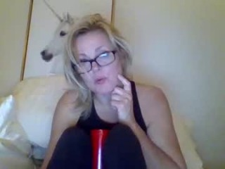 milf52bilf40 Huge breasted blonde squirted honey sucking and riding a giant prick outside